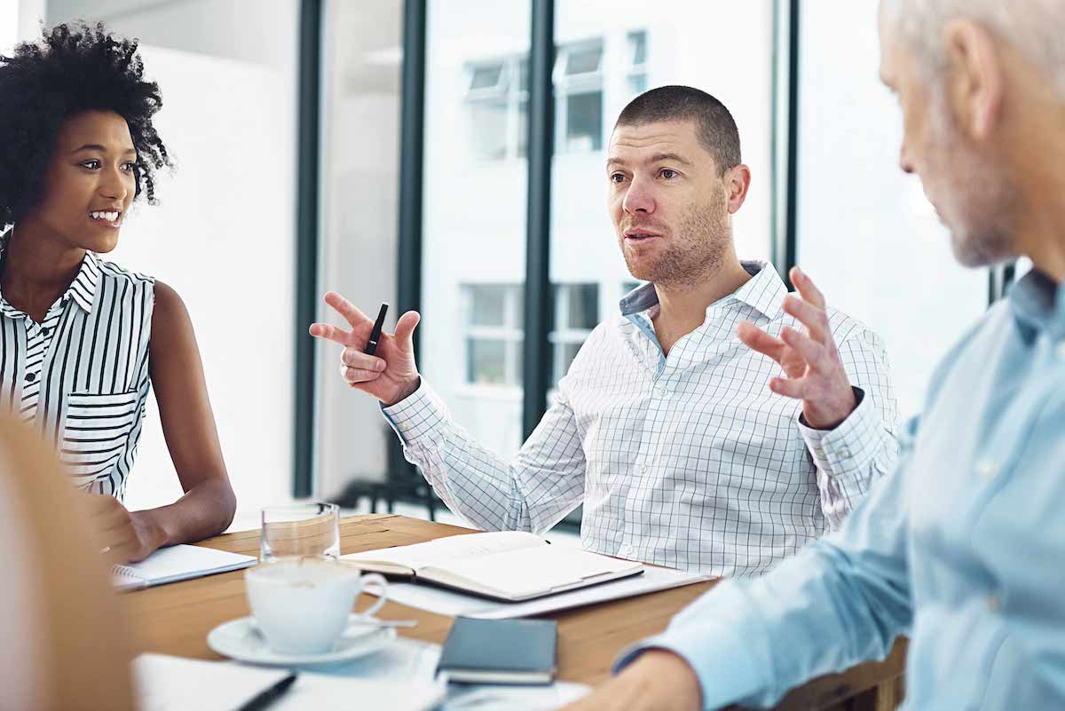 Men and women meeting in office